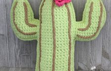 Front view of a crocheted plushy cactus.