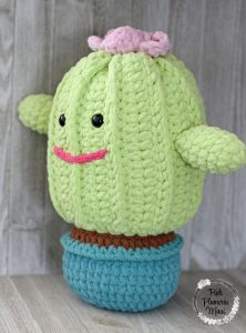 A side view of Primrose a crocheted plushy cactus.