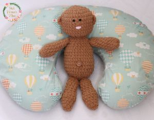 Crocheted Baby on a Nursing Pillow