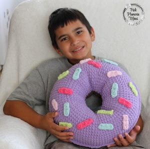 Crocheted Donut Pillow with a smile.